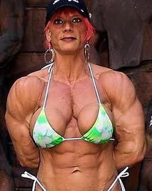 muscular-women-stone-wall.jpg